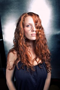 something wrong with glasses redhead woman