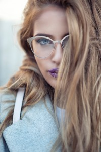 Outdoor portrait of beautiful and sensual brunette young woman how posing with glasses.