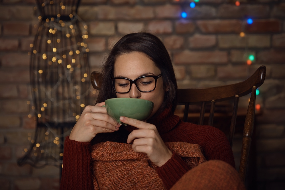 woman sipping on a tea
