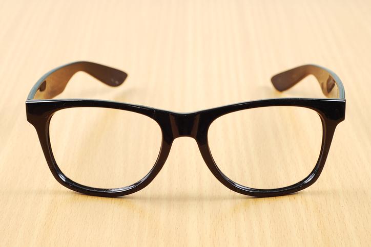 black glasses on wood background